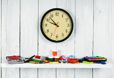 Watches and school tools on a wooden shelf. Royalty Free Stock Image