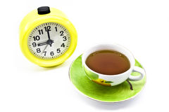 Watches and tea. Hours and a cup on a white background Stock Photography