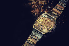Watches in water Stock Photography