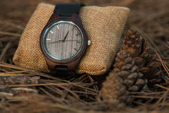 Watches in the woods. Wooden watches beautiful and fashion, natural trend royalty free stock photography