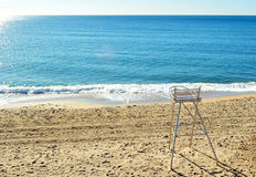 Watchful beach chair in lonely morning. Watchful beach chair lonely morning with sea royalty free stock photography