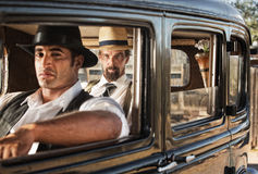 Watchful Pair of 1920s Gangsters. Pair of 1920s gangsters watching from a car Royalty Free Stock Photos