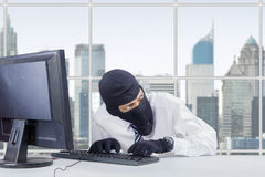 Watchful thief stealing information Stock Photography