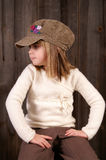 Watching. A young girl waiting on a bench royalty free stock photos