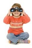 Watching. Little girl watching with binoculars Stock Photography