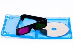 Watching a 3D blu-ray movie. A pair of pink and green 3D glasses on a open blu-ray disc case Stock Photography