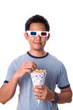 Watching 3D movies. Man watching 3D movies while eating popcorn Royalty Free Stock Image