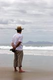 Watching. Man watching the waves royalty free stock photography