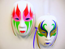 Watching. Two masks against an off-white background Stock Image