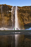 Watching in Awe, Rainbow in the spray off Seljalandsfoss Waterfall, Iceland Royalty Free Stock Photos