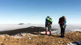 Two friends enjoying a sunny day on top of a mountain in Romania Royalty Free Stock Photography