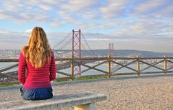 Watching big Lisbon, Portugal. Young beautiful woman watching big Lisbon from viewpoint, Portugal Royalty Free Stock Image