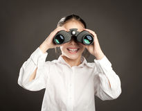 Watching with binoculars Royalty Free Stock Photography