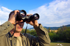Watching through binoculars Royalty Free Stock Photos