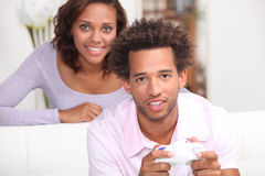 Watching boyfriend playing video games Stock Photo