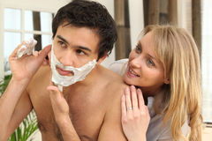 Watching boyfriend shave Royalty Free Stock Photo