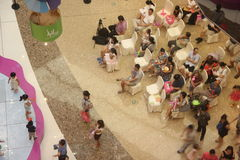 Watching the children show of parents in the SHENZHEN Tai Koo Shing Commercial Center Stock Photography