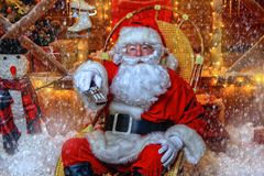 Watching christmas movie. Santa Claus sitting on his armchair and watching a Christmas movie. Entertainment and cinema concept. Merry Christmas and Happy New royalty free stock image