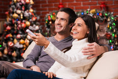 Watching Christmas shows together. Stock Photos