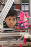 Watching the 3D printer. Royalty Free Stock Photo