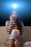 Watching drama movie. Crying young woman watching drama movie in the cinema Stock Photography