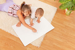 Watching the drawing on white board Royalty Free Stock Photo
