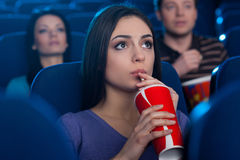 Watching an exciting movie. Royalty Free Stock Photos