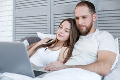 Content couple watching a film together Stock Image