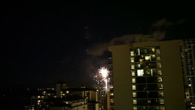 Watching Fireworks from highrise hotel room night. A bird's eye view of fireworks at night from a hotel room balcony stock footage