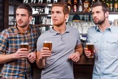 Watching football at the bar. Royalty Free Stock Image
