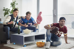 Watching football game stock photography