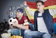 Watching football game Stock Image