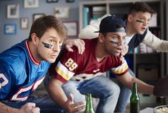 Watching football game stock images