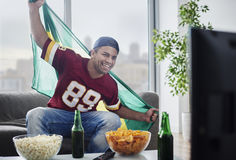 Watching football game stock photo
