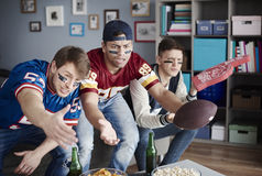 Watching football game. Unhappy men while watching American football Stock Photo