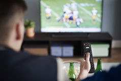 Watching football game royalty free stock photo