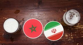 World Cup 2018 Match Calendar, Beer Mats Concept Flyer Background. Watching football together concept. Coasters at the bar with flags and symbols of Morocco Stock Photography