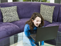 Watching Funny Video on Laptop Royalty Free Stock Photos