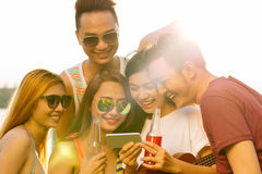 Watching funny video or photo on the smartphone Stock Image