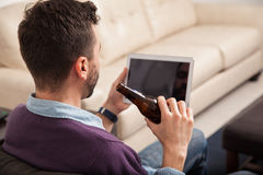 Watching the game on a tablet Stock Photo
