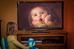 Watching herself on tv Royalty Free Stock Photos
