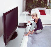 Watching home cinema. Woman in living room watching home cinema royalty free stock photography