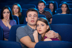 Watching horror movie. Stock Image