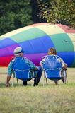 Watching hot air balloons filling Royalty Free Stock Photos