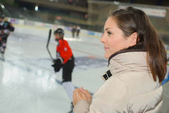 Watching ice hockey game Royalty Free Stock Image