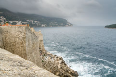 Watching an Impending Storm from the Walls of Dubrovnik. A storm over the Adriatic Sea and the Island of Lokrum as seen from the walls of the old town of Royalty Free Stock Images