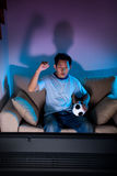 Watching live football on TV Stock Photo
