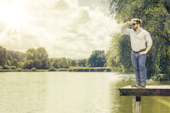 Watching man at the lake. An image of a bearded man at the lake watching Stock Image