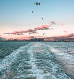 Watching Manhattan disappear on the Staten Island Ferry stock photography