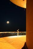 Watching the moon. Night scene on the Telstra tower (Canberra, Australia) with binoculars and the moon Stock Photo